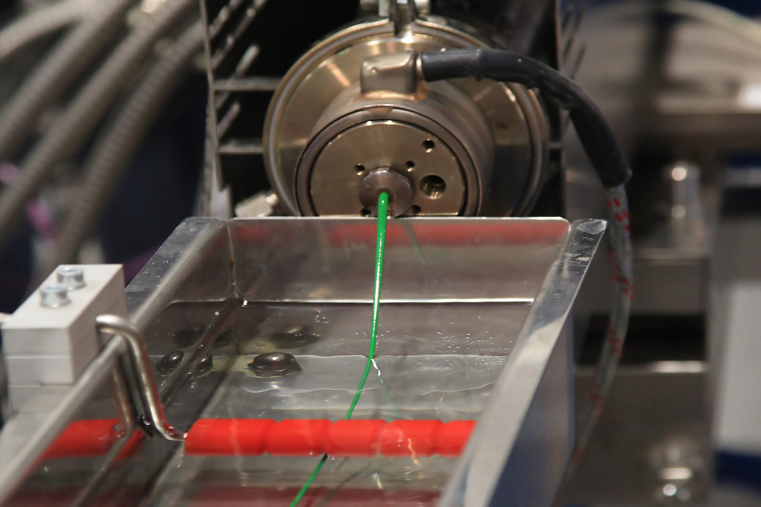 Continuous extrusion of plastic filament